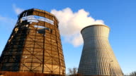 Water cooling tower stack smoke over blue sky video