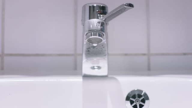 Water Dripping from Bathroom Sink Faucet video