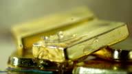 Water Drops Splashing On Gold (Super Slow Motion) video