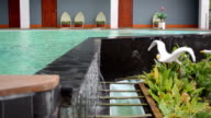 water flowing overflow on swimming pool video