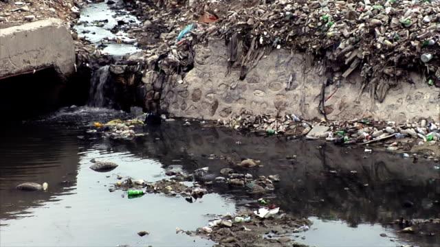 Water Flowing Through Garbage Dump video