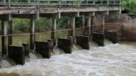 Water flows through dam spillways. video