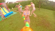 POV Water gun fight at a children's party video