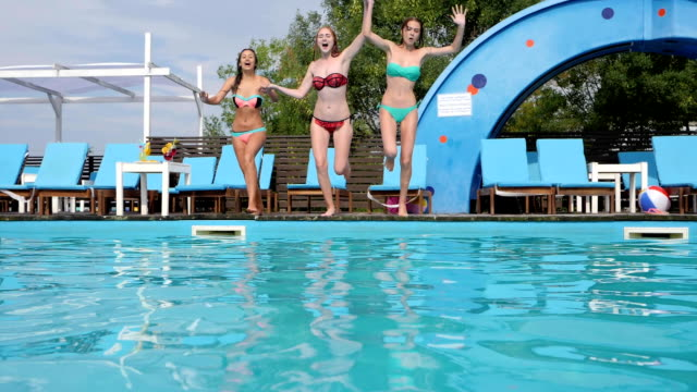 Water party, company of sexy girls in Swimsuit jumps into pool, Summer vacation of friends, beautiful girlfriends video