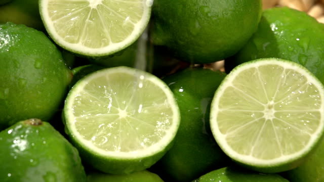 Water poured over fresh limes video