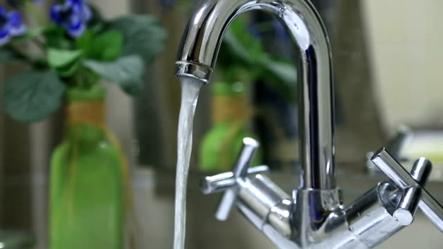 Water pouring out of  bathroom faucet video