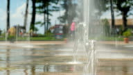 Water pouring out of the ground. The flow of water falls to the ground video