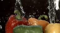 Water pouring over bell peppers video