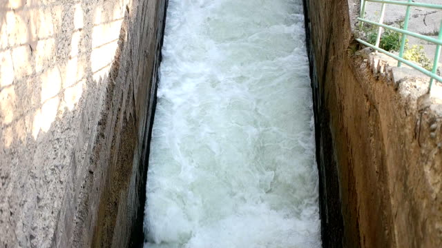 Water rushing out of hydro dam video