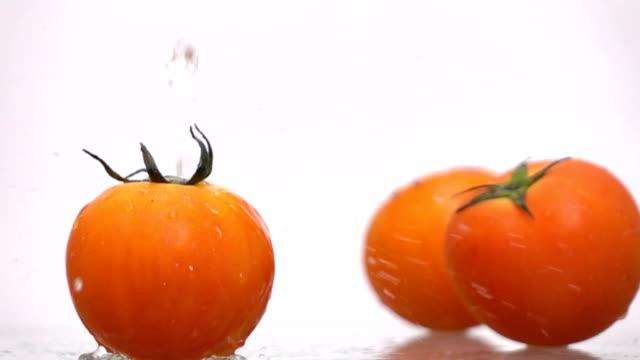 Water splash on tomato slow motion video