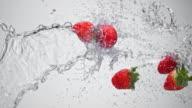 SLO MO Water splashing strawberries in the air video