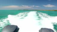 Water Spray splashing from speedboat on beautiful blue sea video