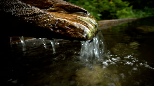 Water Springs from a Wooden Fountain video