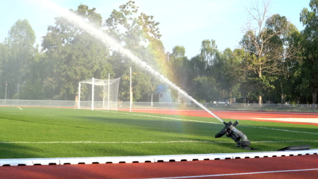 4K MS Water Sprinkler the Soccer Field Green Grass. video