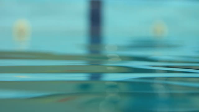 Water surface with a reflection of swimming pool video