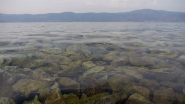 water surface with pebbles in croatia video