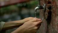 water tap outdoors for refreshment at summer day video