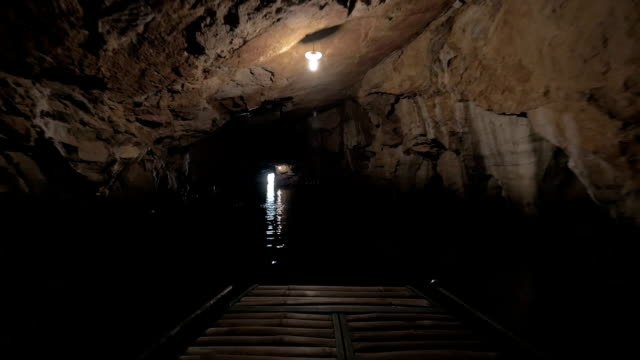 Water travel through the cave in Ha Long Bay, Vietnam video