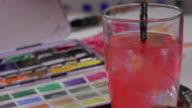 watercolor brush dipped in water video