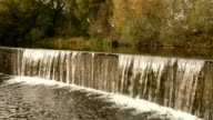 Waterfall cascade. Autumn daytime. Smooth dolly shot. video