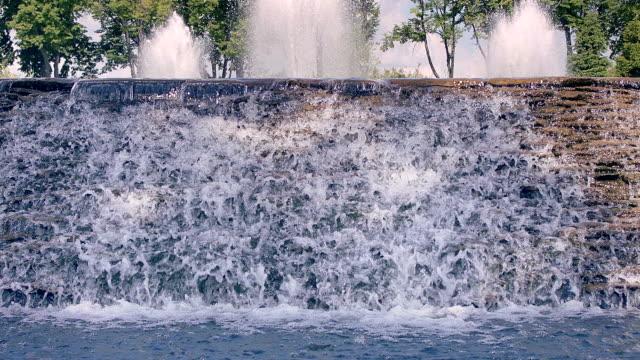 Waterfall closeup. River waterfall. Water falling down over stone cascade video