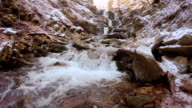 Waterfall in mountain locality in winter video