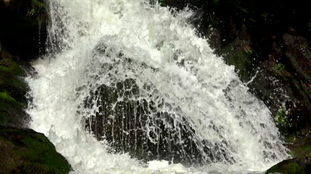 waterfall in mountains closeup in slow motion video