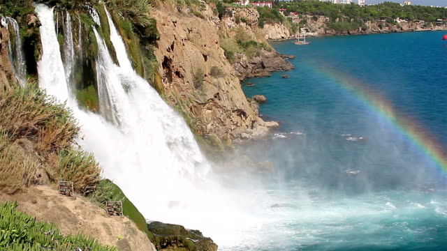 Waterfall with Rainbow over the Sea video