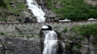 Waterfalls meltwater vehicles on Going-to-the-Sun Road Glacier National Park video