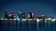 waterfront of city at night blurred loopable video