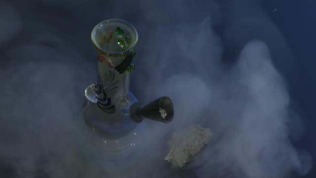 Water-pipe cannabis bud dark background video