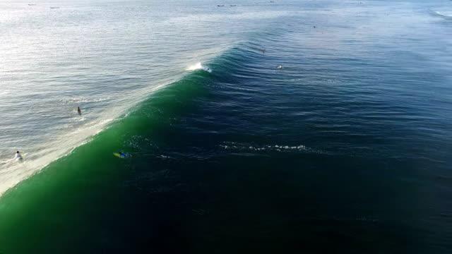 Wave breaking beautifully in the setting sun in Balangan beach, Bali, Indonesia video