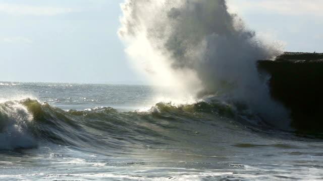 Wave crashing onto rocks video