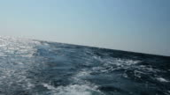 HD: Wave flows behind a boat video