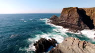 Waves and the picturesque cliff aerial view Portugal video