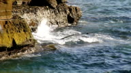 Waves breaking against cliff video