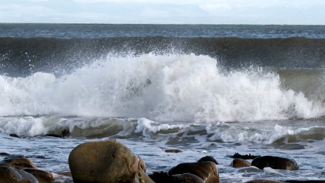 Waves breaking on the shore in Dumfries and Galloway, Scotland video