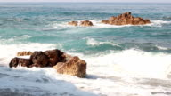 Waves crash on the rocks in the Mediterranean Sea video