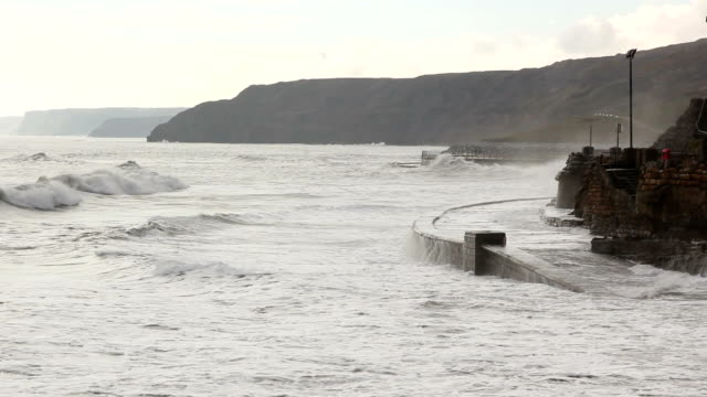 Waves crashing against the coast (two shots) video