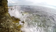 Waves Crashing On Rocks in Slow Motion video