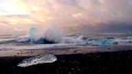 SLO MO Waves crushing against icebergs video