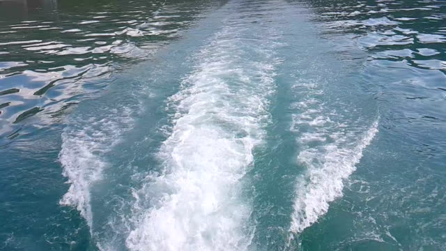 Waves on blue sea behind the boat video