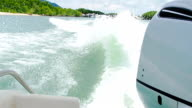 Waves on blue sea behind the speed boat water video