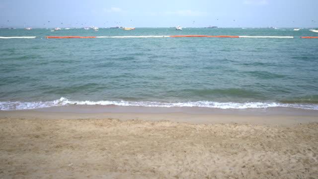 Waves on the beach crashing on sandy shore video