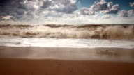 Waves on the sand beach with incredible sky video