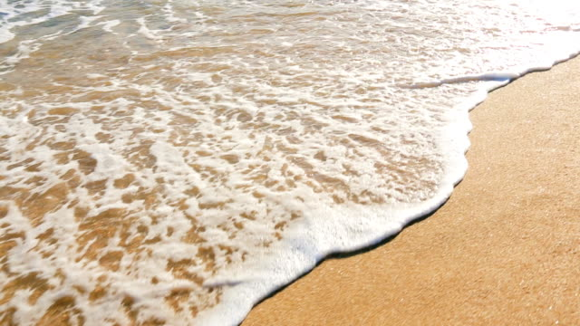 Waves Rolling Gently Up on White Sandy Beach. video