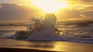 SLO MO Waves splashing icebergs on the beach video