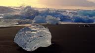 SLO MO DS Waves splashing over icebergs video