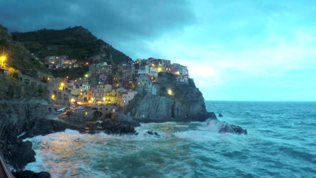 Waves washing rocks near beautiful Positano village in Italy, storm timelapse video