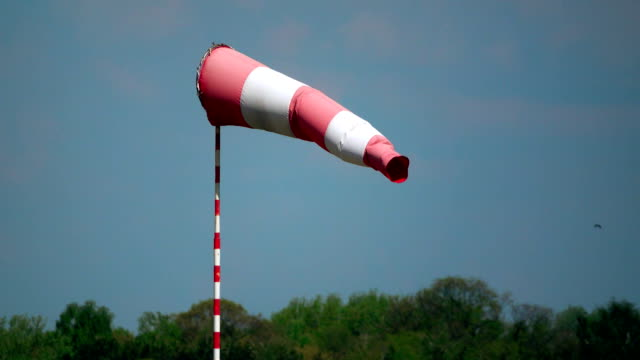 Waving airport weather vane or wind flag FullHD telephoto lens shot video